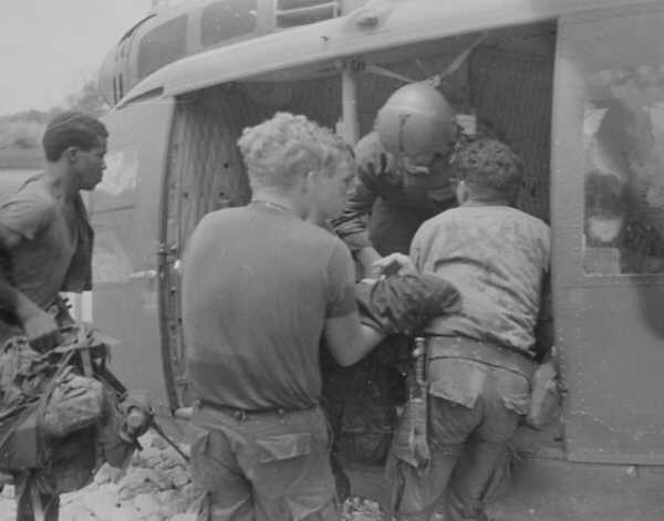 Soldiers From Co C 1st Battalion 6th Infantry Carried A Wounded Man Toward Dust Off Helicopter On 9 July 1969 During An Operation In The Rocket